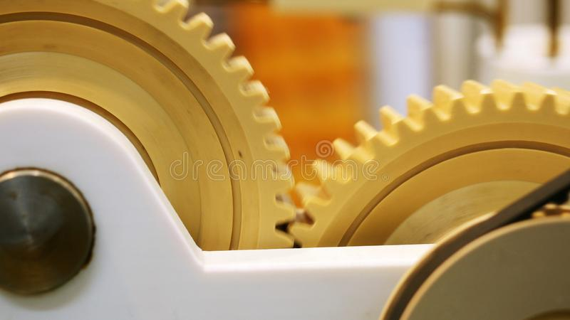 Close-up view of modern mechanism with plastic rotating gears. Media. Different working devices collection presented on stock photos