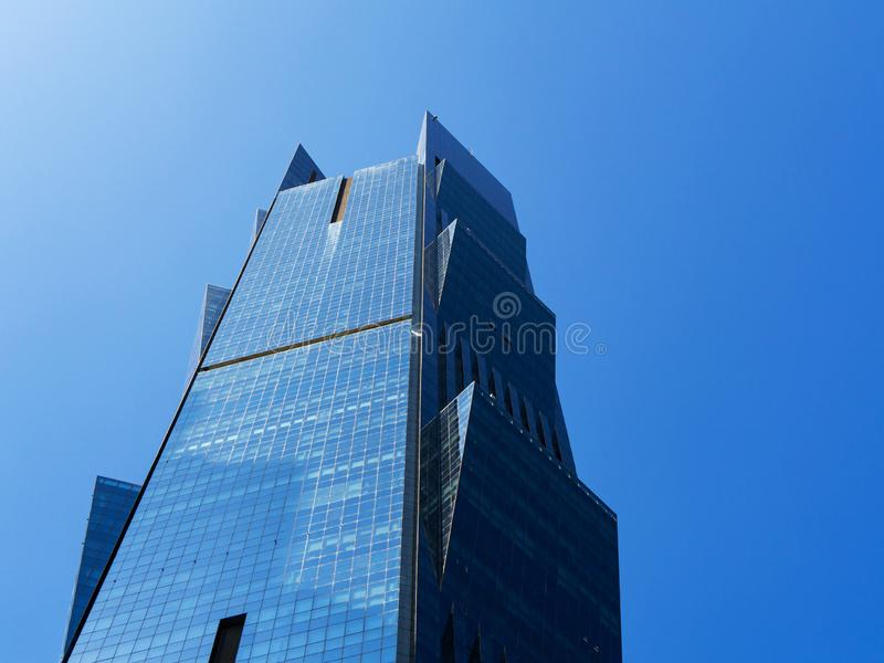 Close up view of modern skyscraper Palm Tower in Doha, Qatar. Close up view of modern skyscraper with glass facade Palm Tower in Doha, Qatar against clear blue stock images