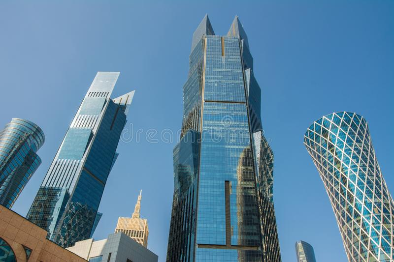 Close up view of modern skyscrapers with glass facade financial and business center in Doha, Qatar. Against clear blue sky stock images