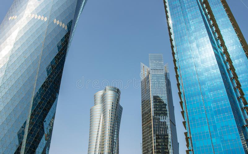 Close up view of modern skyscrapers with glass facade financial and business center in Doha, Qatar. Against clear blue sky royalty free stock photography