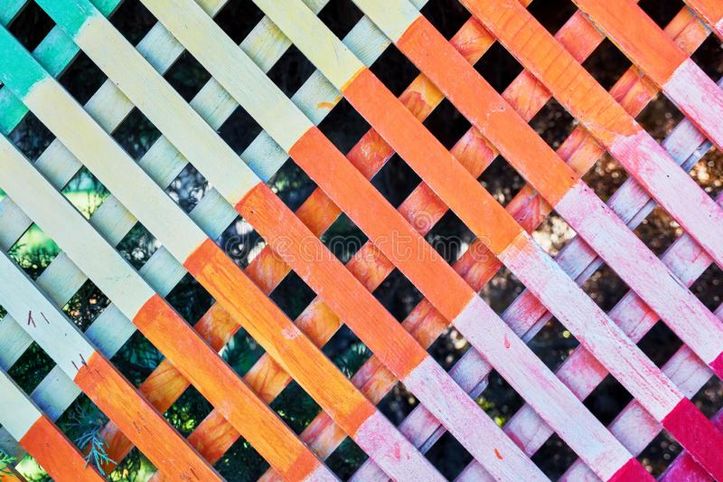 Multi colored checkered wooden fence royalty free stock image