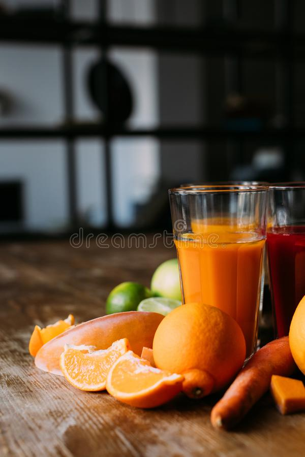 Healthy smoothies with ingredients. Close-up view of natural fresh smoothies in glasses and ingredients on table stock photography