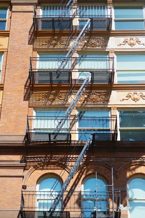 Close-up view of New York City apartment buildings with emergency stairs in Little Italy neighborhood of Manhattan NYC. USA stock photo