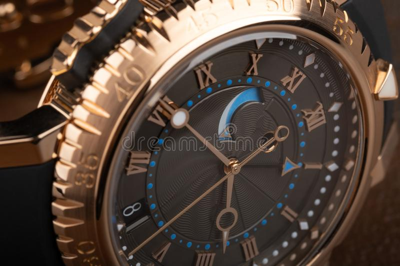 Close up view of nice man`s wrist watch on black background stock photos