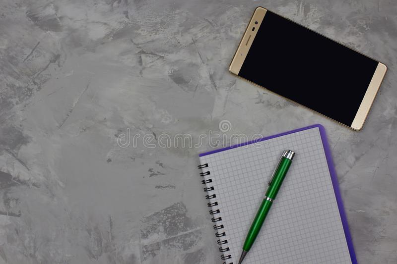 Close up view of notepad, pen and mobile phone on for marble background with copy space for text. stock photos