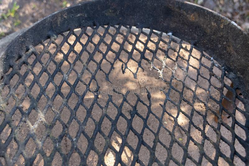 A Damaged braai Grid. A close up view of a old rusted braai or barbaque food grid with damaged on the one side caused by heat royalty free stock photos