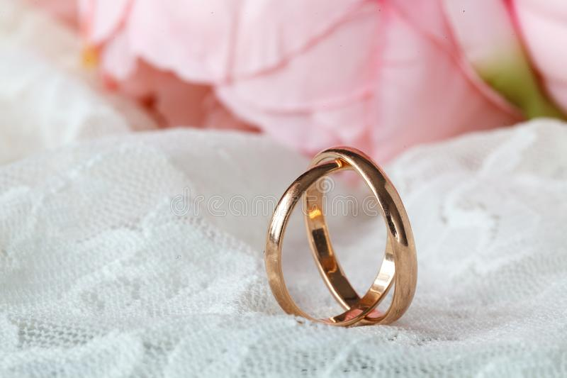 Close up view of pair golden wedding rings royalty free stock photo