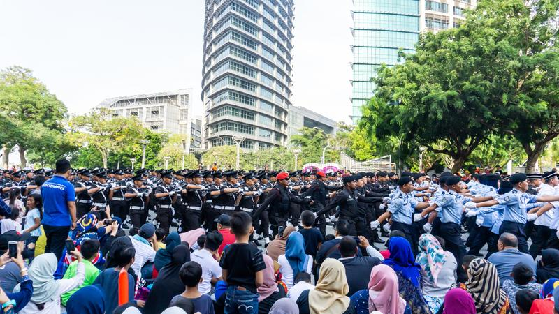 The close up view of the parade contingent marching at the 62nd Independence day or Merdeka Day celebration of Malaysia. royalty free stock images