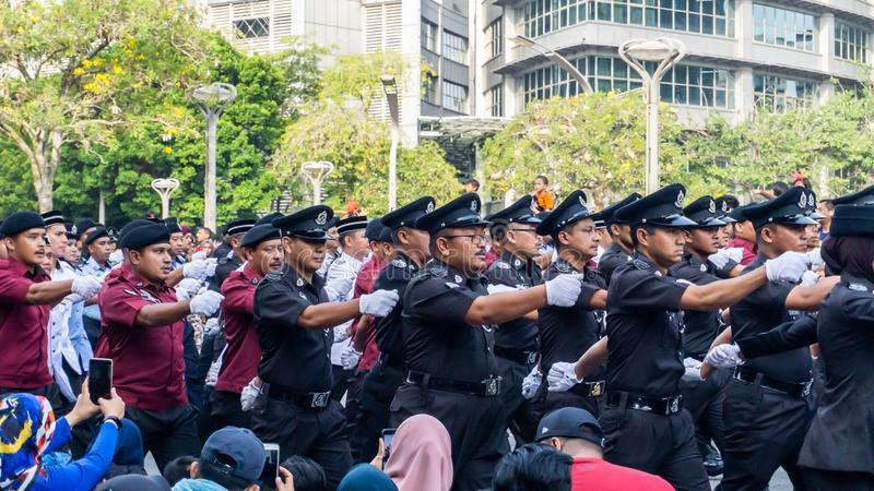 The close up view of the parade contingent marching at the 62nd Independence day or Merdeka Day celebration of Malaysia. royalty free stock image