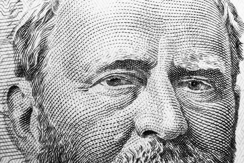 Close up view Portrait of Ulysses S. Grant on the one fifty dollar bill. Background of the money. 50 dollar bill with Ulysses S. G. Rant eyes macro shot. Money royalty free stock photo