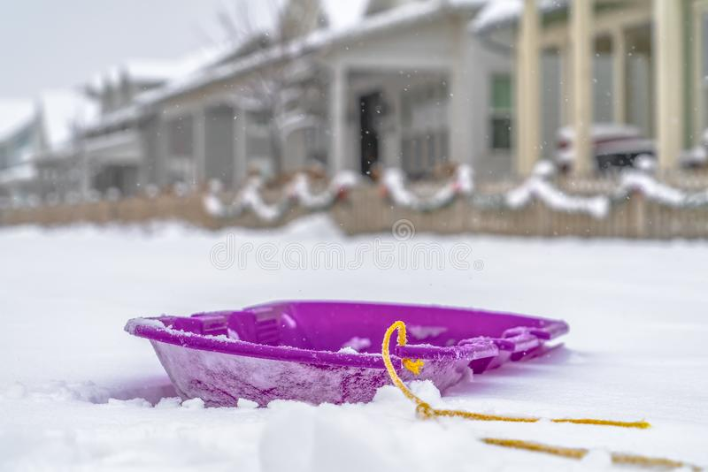 Close up view of a purple sled against frosty snow royalty free stock image