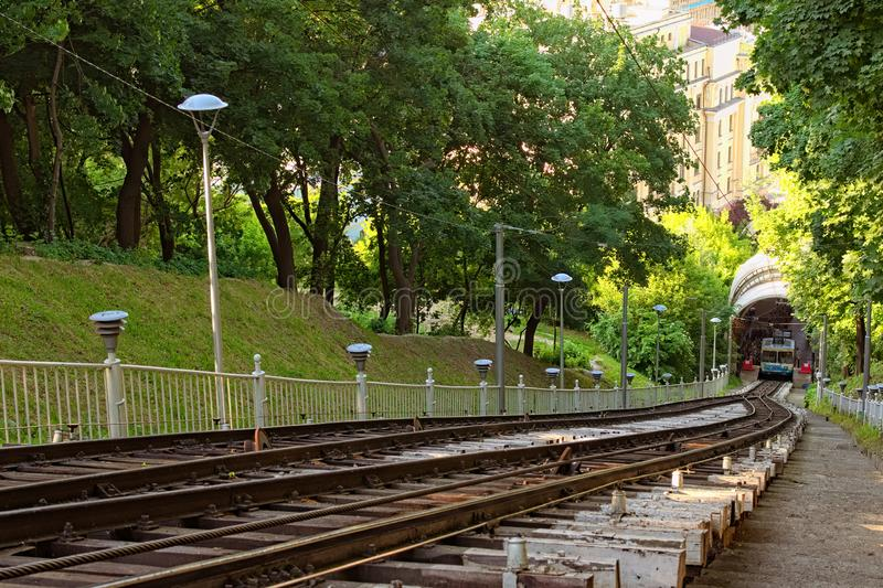 Close up view of rails path funicular, vertical path, sleepers, cable for the funicular. the lower station on the background stock photography