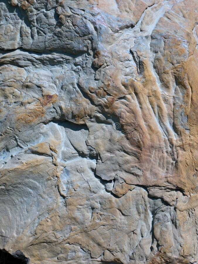 Close-up view of rock eroded by the flow of water. royalty free stock images