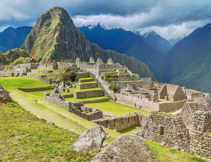 The dramatic scenery of Machu Picchu, looking at the ruins near the base of Huayna Picchu. royalty free stock photo