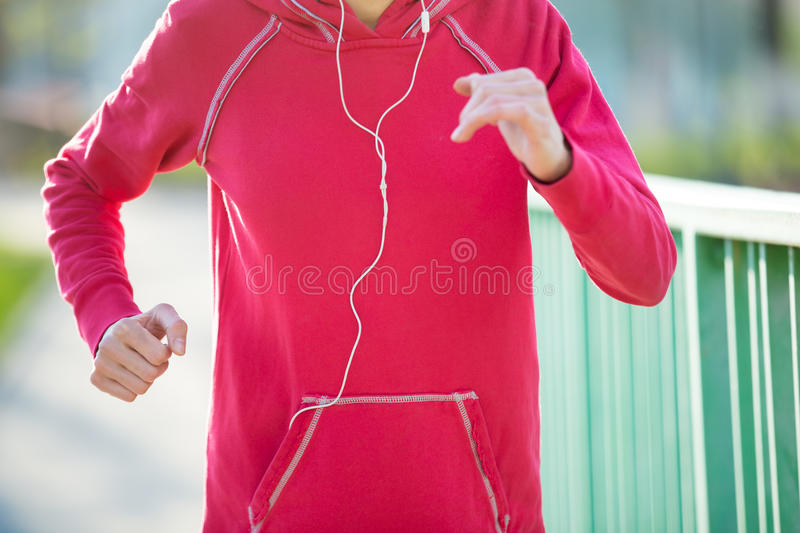 Close-up view of runner woman working out on the street stock photography