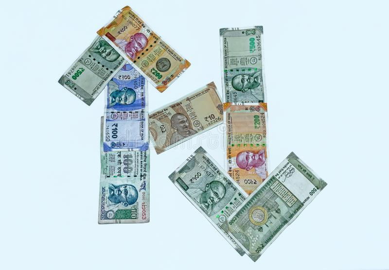 Close up view of 200,500,100 and 10 rupees Indian currency notes. On white isolated background.High angle view royalty free stock photos