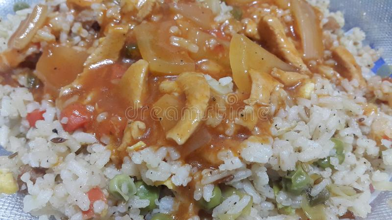 Close up view of sauce on white fried rice Chinese dish stock images