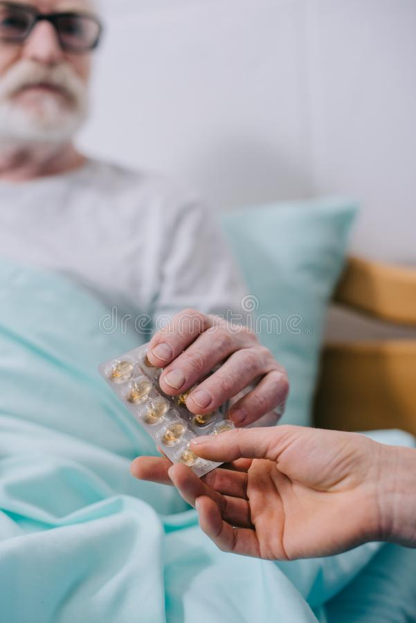 Close-up view of senior patient taking medications from royalty free stock image