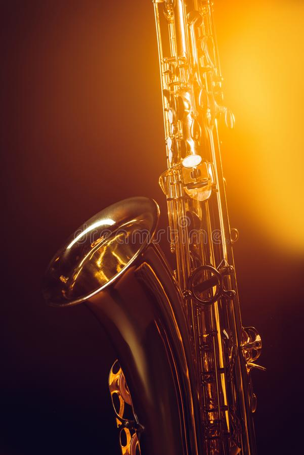 Close-up view of shiny professional saxophone and spotlight. On black stock image