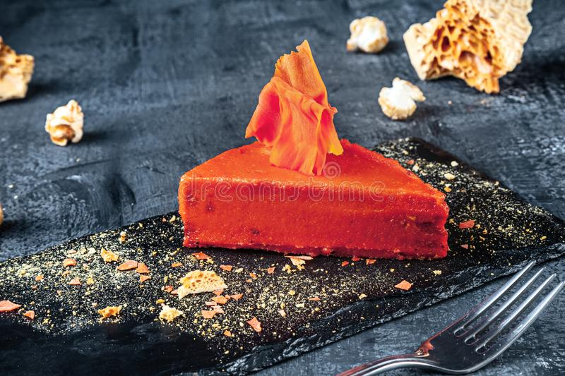 Close up view on slice of orange cake. Dessert food for breakfast. Served ready to eat sweets. Copy space for text stock images
