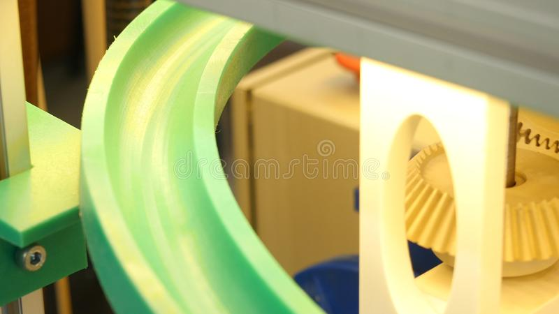 Close-up view of small balls rotating on the spiral in mechanism with gears. Media. Different working devices collection stock photos
