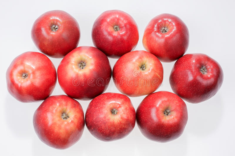 Close up view of some red apples isolated on white stock photo