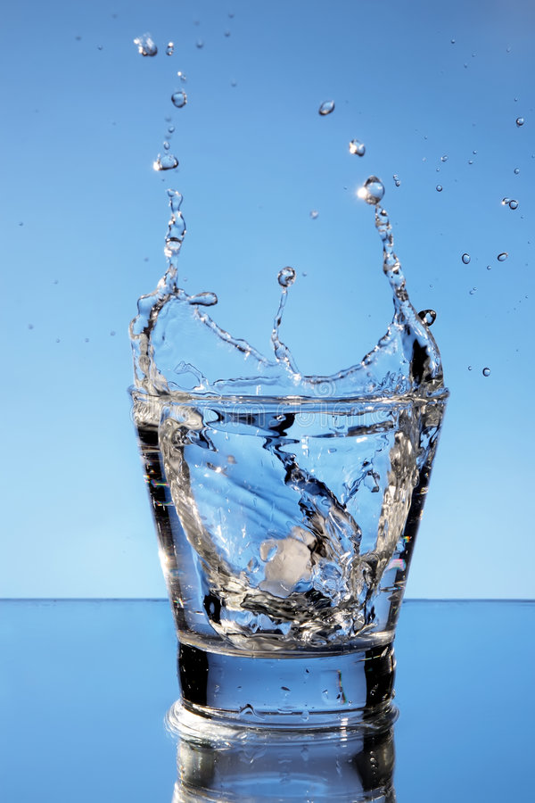 Close up view of the splash in water stock images