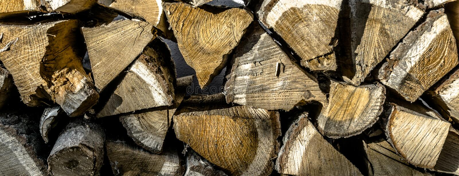 Close-up view of a stack of chopped wood for the fire in the fir. Close-up view of a stack of chopped wood for the fireplace fire in winter, background or royalty free stock image
