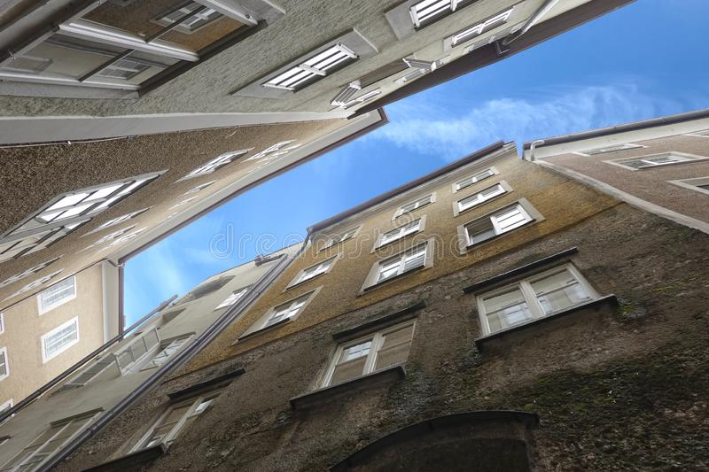 Close up view standing buildings bottom up view in typical west european city on narrow street. Dense standing buildings bottom up view in typical west european royalty free stock photo