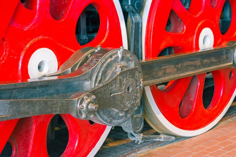 Close up view of steam locomotive wheels, drives, rods, links and other mechanical details. White, black and red colors. stock images