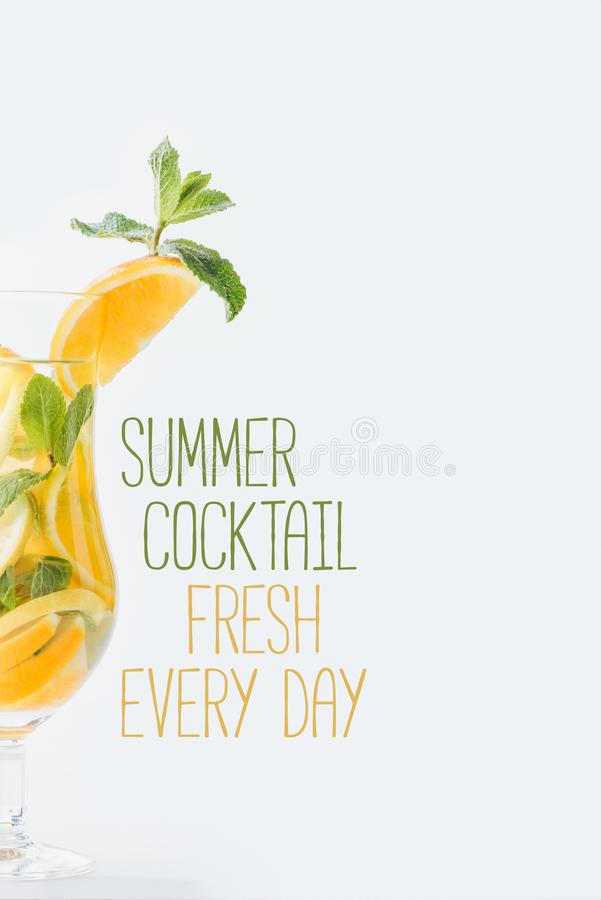 Close up view of summer fresh cocktail with mint and pieces of citrus fruits, summer cocktail fresh every day lettering. Isolated on white royalty free stock images