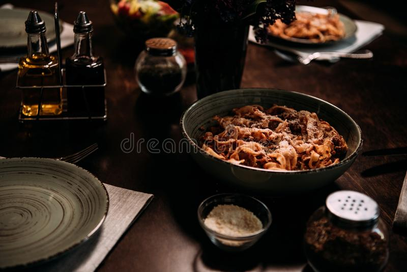 close-up view of tasty meal and cutlery on table served stock image