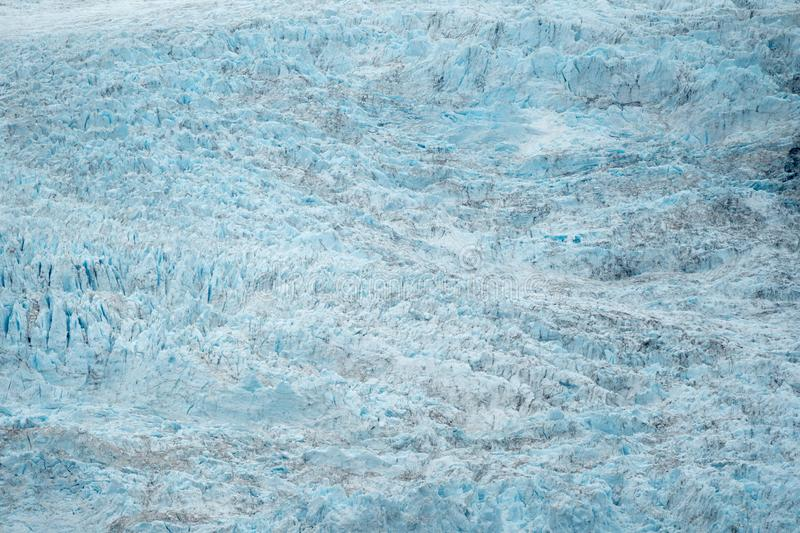 Close up view of teal blue colored Holgate Glacier in Alaska stock photo