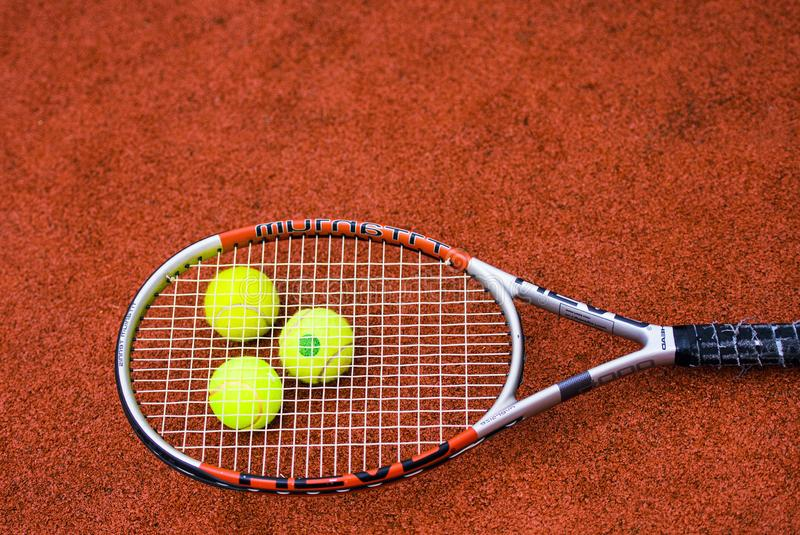 Close up view of tennis racket and balls on the clay tennis court. Activity, background, blue, closeup, color, competition, concept, equipment, exercise royalty free stock photos