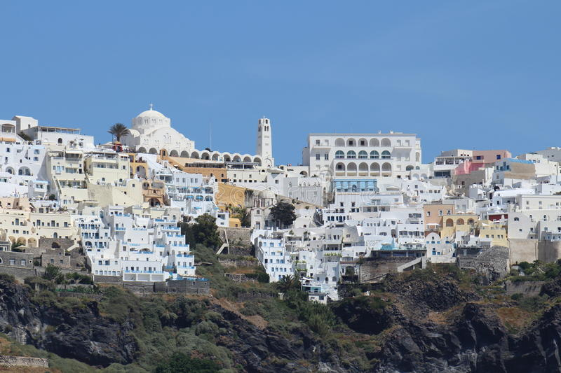 Close up view of Thira with white houses and church - Town in Sa stock image