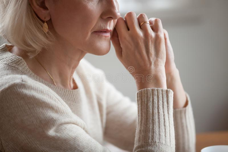 Close up view of thoughtful mature woman worried about problems royalty free stock photos
