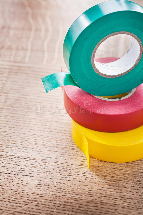 Close up view three rolls of insulating tape stock photography