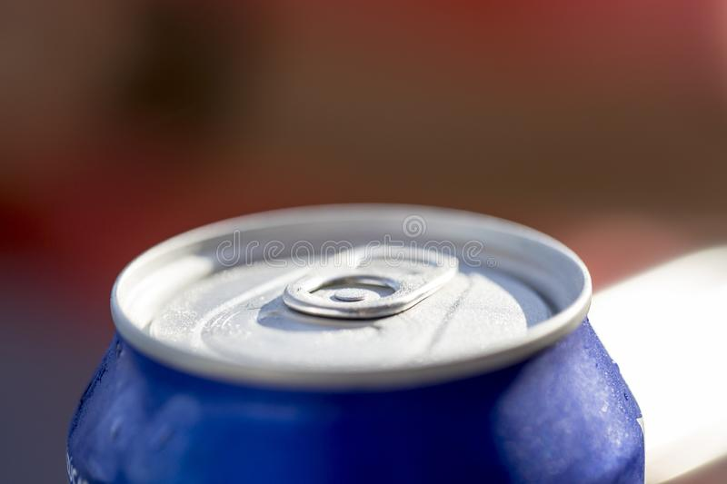 Close-up view of the top of a can drink with condensation. royalty free stock photography