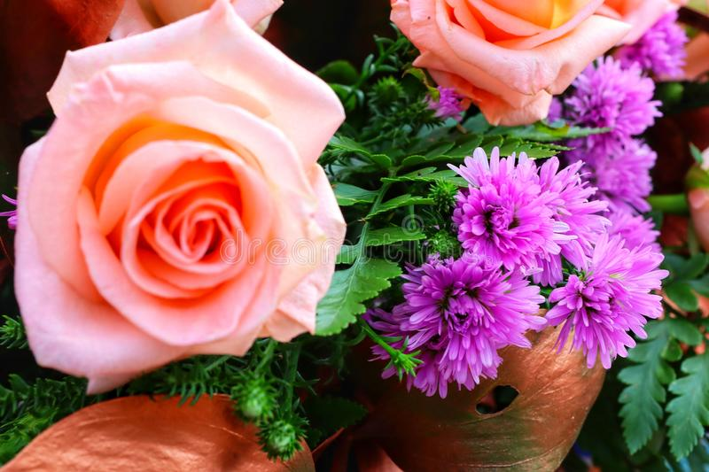 Close-up view, top view, rose, orange, beautiful pastel, bouquet of flowers. Green stock photography