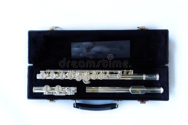 Close-up view, top view, flute instrument in black box, white background royalty free stock images