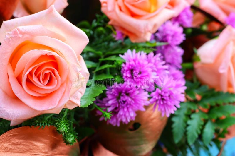 Close-up view, top view, rose, orange, beautiful pastel, bouquet of flowers. Green stock photos
