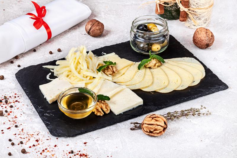 Close up view on traditional Georgian served assorted cheeses with honey and nuts. stock photos