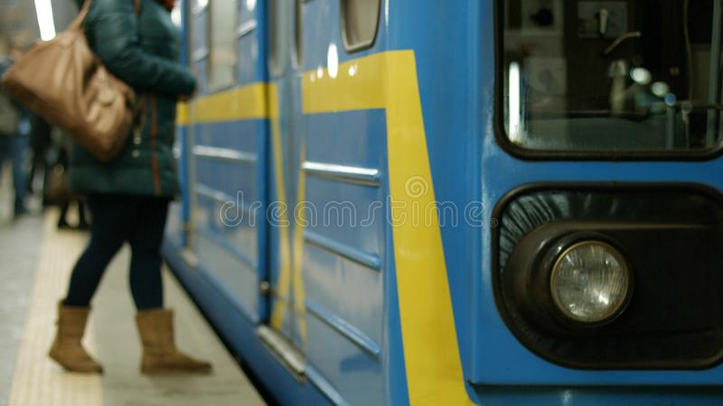 Close up view of train at indoor subway station. Metro subway train in station close up. Passengers enter the subway wagon stock photo