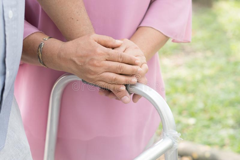 close-up view two seniors holding hands together. royalty free stock photo