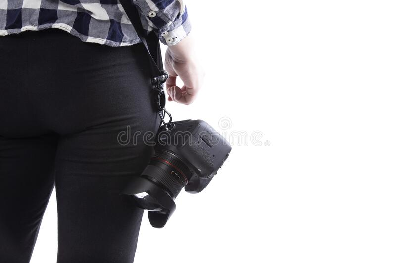 Close up of Photographers Camera and Lens royalty free stock photo