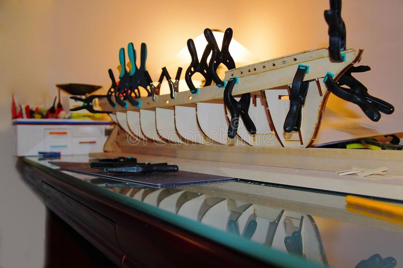 Close up view of unfinished wooden model of ship Danmark. Hobby background stock images