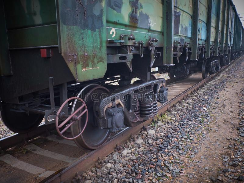 Close up view on used rusted railway freight car bogie with wheel sets with axleboxes, coil springs. Freight train on the railwayC royalty free stock images