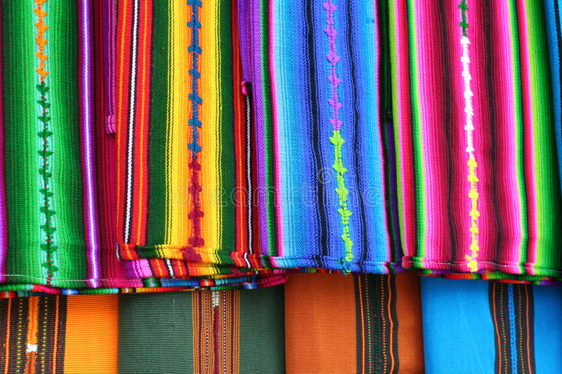 Close up View of Vibrant Indigenous Mayan Textiles. Red, blue, yellow, green, pink colors all stand out in beautiful striped patterns of the local Indigenous stock image