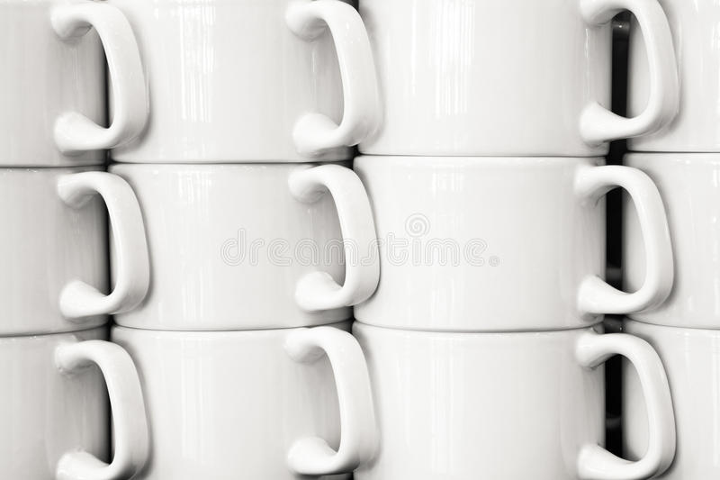 Close up view of white coffee mug columns royalty free stock photography