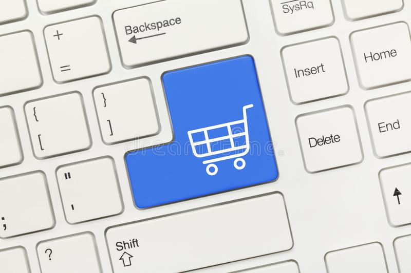 White conceptual keyboard - Shopping cart symbol blue key. Close-up view on white conceptual keyboard - Shopping cart symbol blue key stock image
